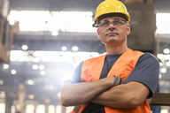 Portrait serious confident steel worker in factory - CAIF09842