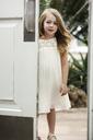 Portrait of girl standing by door - CAVF04999