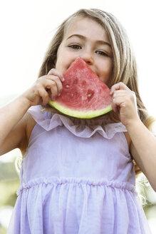 Portrait of girl eating watermelon in backyard against sky - CAVF05026