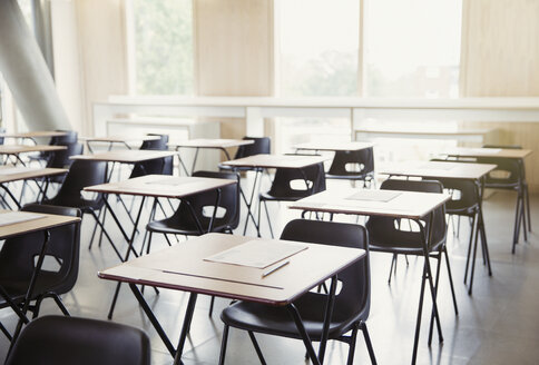 Tests on desks in empty classroom - CAIF10009