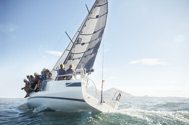 Retired friends on sailboat under blue sky - CAIF10147