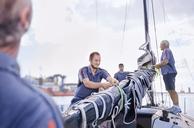 Men preparing sailing equipment - CAIF10159