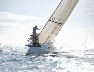 Sailboat heeling on sunny ocean - CAIF10165