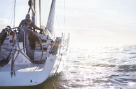 Retired couple sailing on sunny ocean - CAIF10174