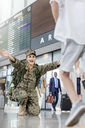 Son running greeting mother soldier at airport - CAIF10207