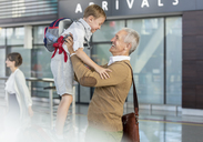 Son greeting father at airport - CAIF10252