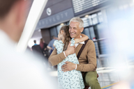 Daughter greeting and hugging father at airport - CAIF10258