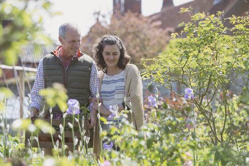 Couple shopping in plant nursery garden - CAIF10336