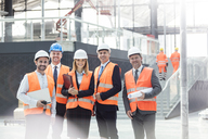 Portrait confident engineers and architects at construction site - CAIF10465