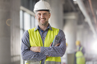 Portrait smiling engineer at construction site - CAIF10489