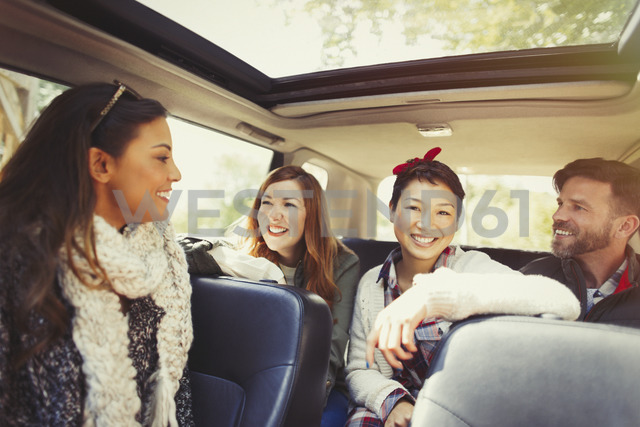 Friends talking and riding in car - CAIF10699