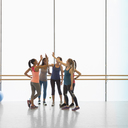 Women high fiving in gym studio - CAIF10768