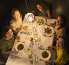 Portrait smiling women friends dining at restaurant table - CAIF10777
