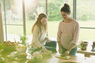 Pregnant women preparing food - CAIF10858