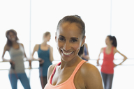 Portrait smiling woman in exercise class gym studio - CAIF10954