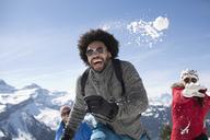 Friends enjoying snowball fight - CAIF11002