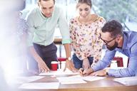 Business people brainstorming in meting - CAIF11050