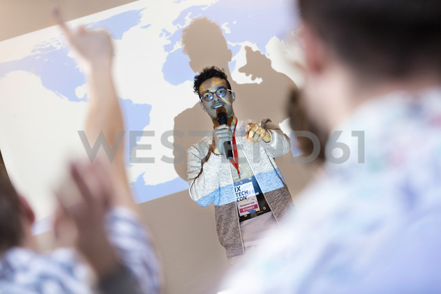 Speaker at projection screen answering questions at technology conference - CAIF11113