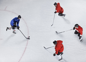 Hockey defenders guarding opponent with puck on ice - CAIF11161