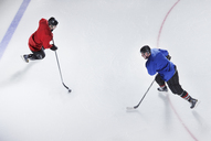 Overhead view hockey opponents with puck - CAIF11170