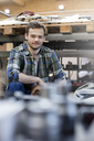 Portrait confident mechanic in auto repair shop - CAIF11221