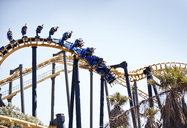 People flipping upside-down on amusement park ride - CAIF11302