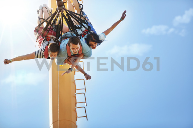 Friends bungee jumping at amusement park - CAIF11308