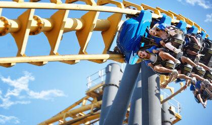 Friends riding amusement park ride - CAIF11311