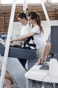 Physical therapist guiding man on treadmill - CAIF11353