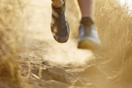 Close up of runner's feet on dirt trail - CAIF11569