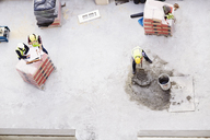 Overhead view of construction workers laying concrete at construction site - CAIF11628