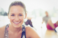 Close up portrait smiling woman in exercise class - CAIF11697