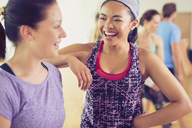 Laughing women in exercise class - CAIF11724
