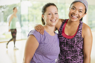 Portrait smiling women in exercise class - CAIF11727