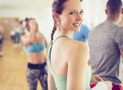 Portrait smiling woman in exercise class - CAIF11778