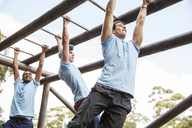 Men on monkey bars at boot camp - CAIF11925