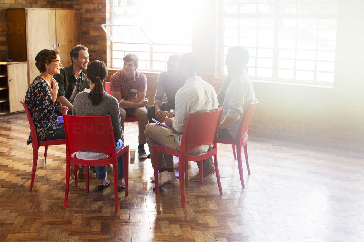 Group therapy session in circle in sunny community center - CAIF11952 - Martin Barraud/Westend61