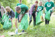 Environmentalist volunteers picking up trash - CAIF11994