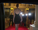 Silhouette of celebrity in black dress arriving at red carpet event - CAIF12033
