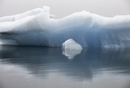 Blue iceberg formation in calm water, Jokulsarlon, Iceland - CAIF12240