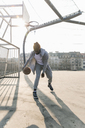 Basketball player in action on court - UUF13002