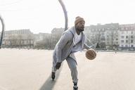 Basketball player in action on court - UUF13005