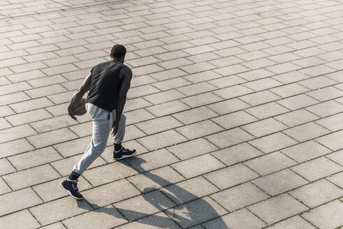 Basketball player in action on a square - UUF13023