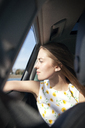 Woman looking through car window while traveling - CAVF06040