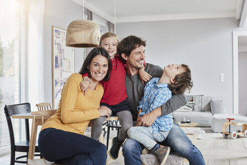 Portrait of happy family with two kids at home - RORF01185