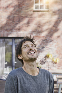 Portrait of happy man in front of his home - RORF01191