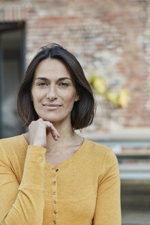 Portrait of confident woman in front of her home - RORF01194