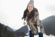 Portrait of happy woman in snow - CAIF12354