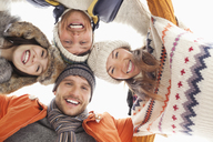 Low angle portrait of happy friends in huddle - CAIF12387