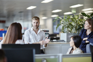 Businessman leading meeting in office cubicle - CAIF12633